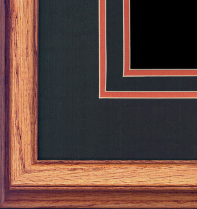Oak frame with double-cut dark olive and burnt orange mat